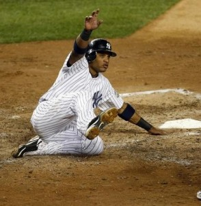 Cano sliding into home