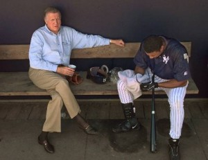 New York Yankees owner George Steinbrenner, left, talks to Yankees center fielder Bernie Williams in the dugout after Williams took batting practice Friday, Feb. 26, 1999, at Legends Field in Tampa, Fla.  The Yankees annnounced Thursday they plan to merge with the New Jersey Nets to form a new company called YankeeNets, which will oversee the business operations of the New York Yankees and the New Jersey Nets.(AP Photo/Kathy Willens)