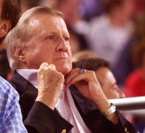 New York Yankees owner George Steinbrenner tugs his collar during the team's sixth inning eight-run rally against the Philadelphia Phillies Wednesday, June 9, 1999 in Philadelphia. (AP Photo/ George Widman)