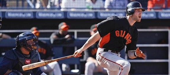 No batting gloves? Gamer. (Lenny Ignelzi/AP)