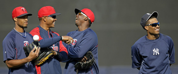 """""""Hey Robinson, how are your injured teammates doing?"""" """"Hey Twins guys, how have you been doing in the ALDS?"""" (AP Photo/Kathy Willens)"""