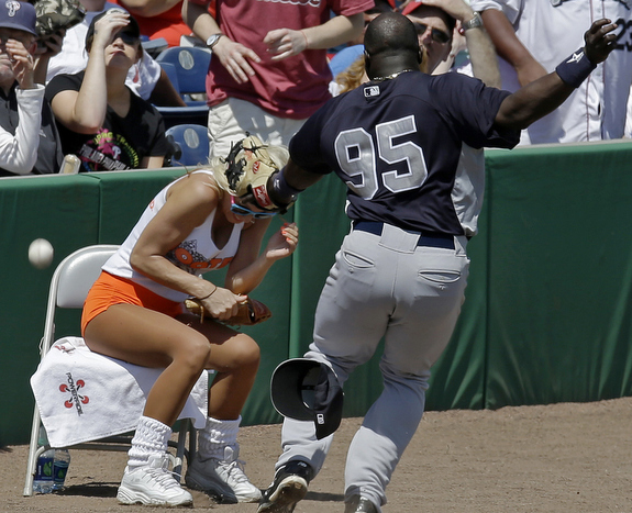 Someone forgot to tell the Hooters girl to get out of the way of popups. (AP Photo/Kathy Willens)