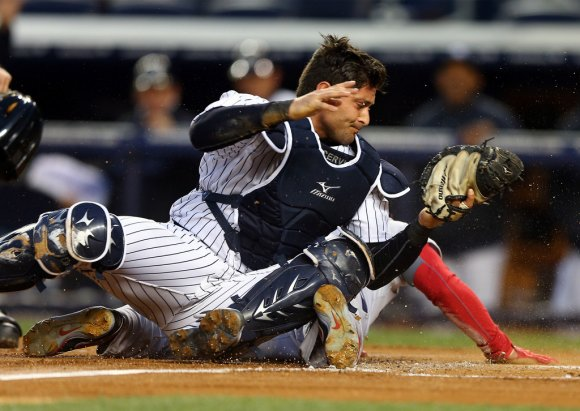 He might be boneheaded sometimes, but maybe Cervelli isn't the worst defender. (Elsa/Getty Images)