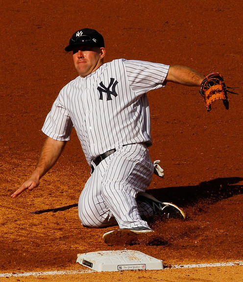 The play that re-injured Youkilis' back. (Mike Stobe/Getty)