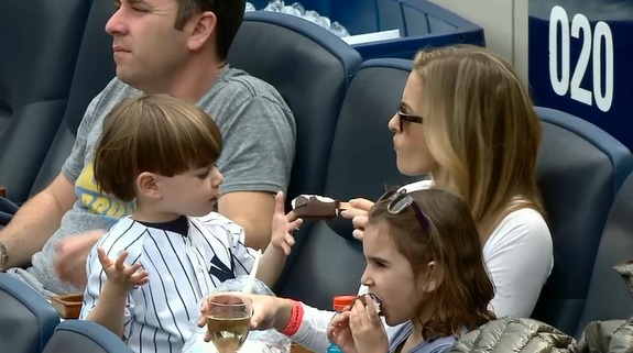 The perfect New Yankee Stadium shot: ice cream in one hand and champagne in the other.