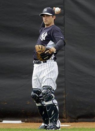 The third catcher? (AP Photo/Matt Slocum)