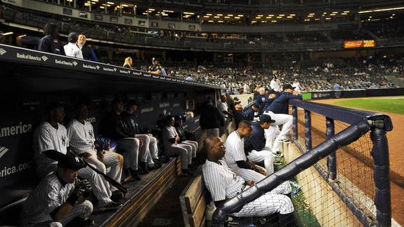 Looks like a dugout that just learned their season was over. (Maddie Meyer/Getty)