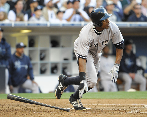 One of the 115 homers Granderson slugged in his four years with the Yanks. (Denis Poroy/Getty Images)