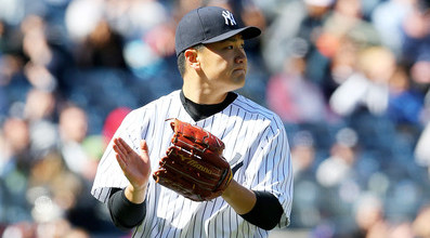 Tanaka applauds in approval of his own outing. (Elsa/Getty)