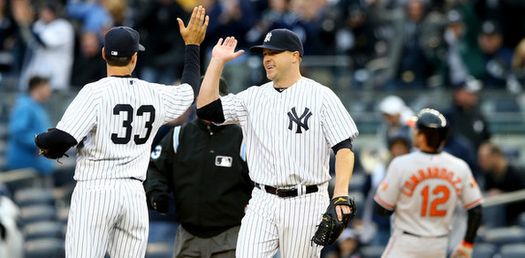 First baseman Kelly Johnson high fives closer Shawn Kelley. Just like we all expected. (Elsa/Getty)