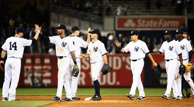 This is how you celebrate when you almost blow a 7-run lead in the 9th inning (USA TODAY Sports).