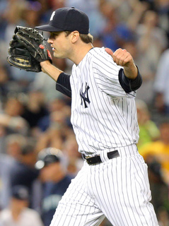 Jul 17, 2015; Bronx, NY, USA; New York Yankees relief pitcher Andrew Miller (48) reacts during the ninth inning against the Seattle Mariners at Yankee Stadium. The Yankees defeated the Mariners 4-3. Mandatory Credit: Brad Penner-USA TODAY Sports