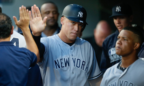 Fan falls into Yankees dugout during win over Seattle