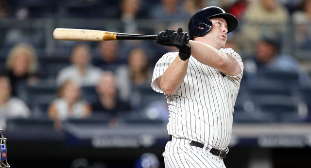 Sep 6, 2016; Bronx, NY, USA; New York Yankees designated hitter Brian McCann (34) hits a solo home run against the Toronto Blue Jays inning at Yankee Stadium. Mandatory Credit: Brad Penner-USA TODAY Sports