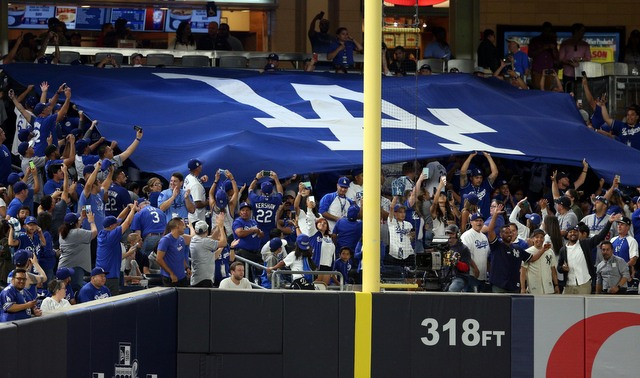 You see a giant Dodgers flag in Yankee Stadium, ownership sees tickets sold. (Presswire)
