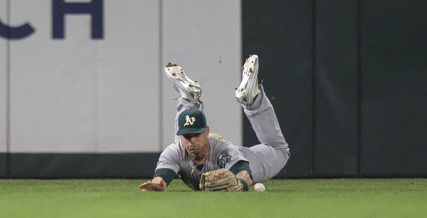 Jake Smolinski was the A's everyday center fielder in the second half. (Stephen Brashear/Getty)