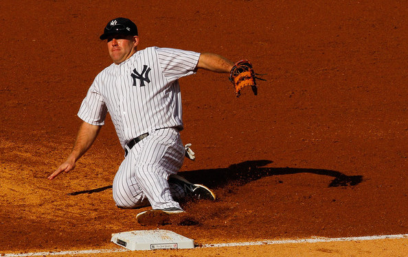 Easy on the back, Youk. (Mike Stobe/Getty)