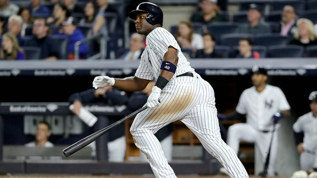 Believe it or not, Chris Carter got a hit on this one. (Elsa/Getty Images)