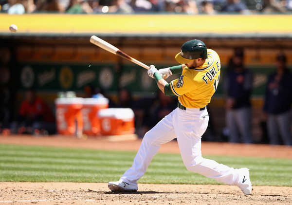 A's hit 4 HRs, rough up Gray, Yankees, end 3-game skid