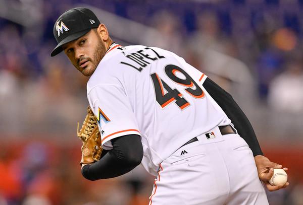 Chapman leaves injured as Yankees edge Marlins in Stanton's return