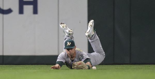 Jake Smolinski was the A's everyday center fielder in the second half. (Stephen Brashear/Getty)