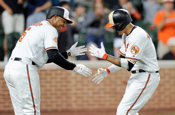 Schoop and Machado. (Greg Fiume/Getty Images)