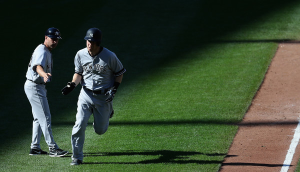 No one ever takes pictures of the third base coach. (Rob Carr/Getty)